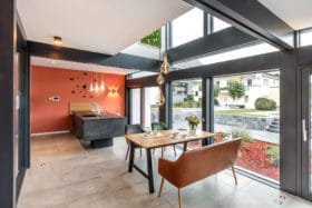 Fusion post and beam show home by Meisterstueck-Haus