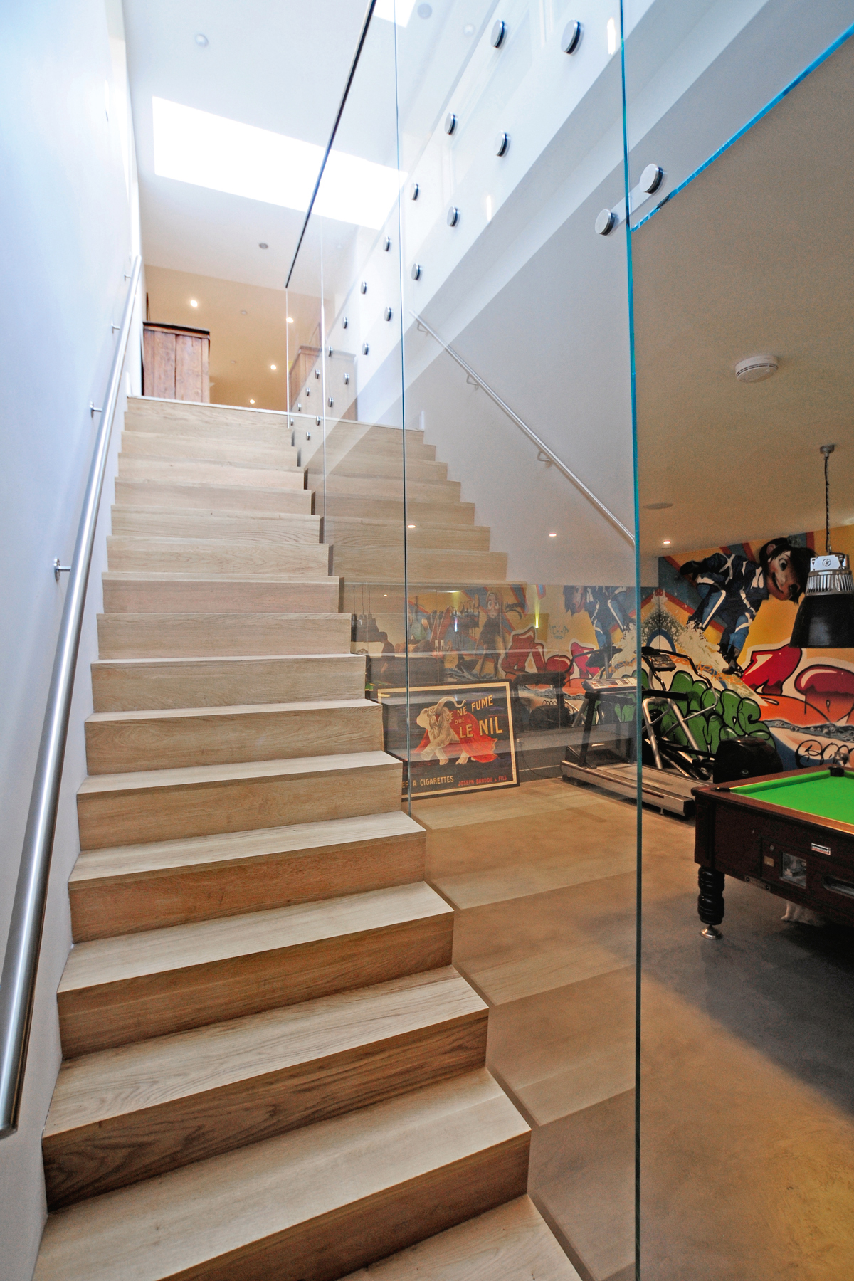 Glass balustrade on staircase leading to basement