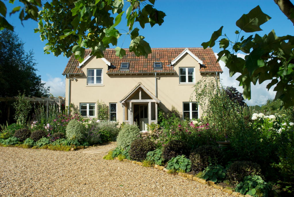 Cottage renovation and extension with render and timber cladding