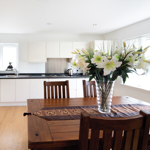 modern kitchen with vase of flowers
