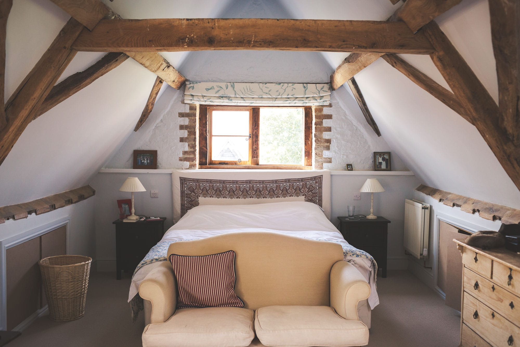 Bedroom in barn conversion with beams