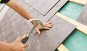 roofer laying roof slates