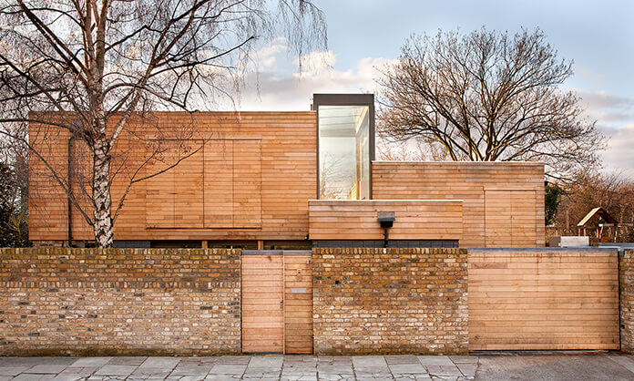 Contemporary home clad in jointed british sweet chestnut
