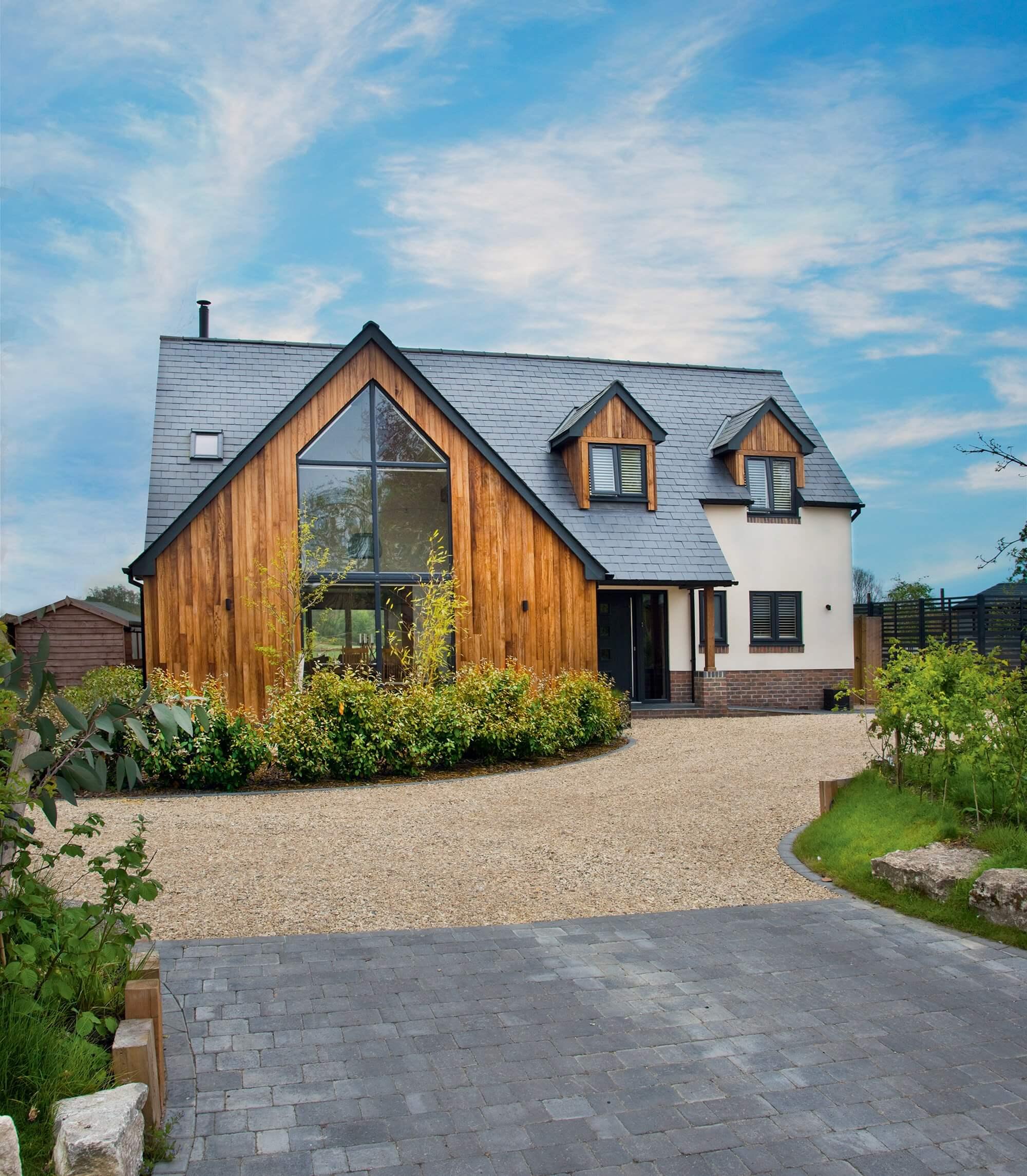 Modern timber frame home with iroko cladding