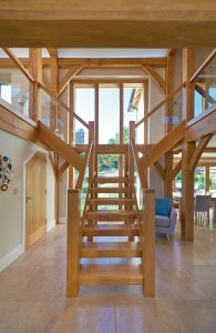 Green oak staircase with glass balustrades