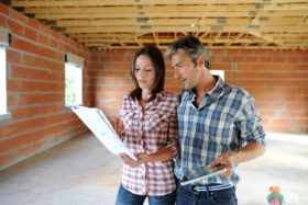 Couple looking at documents in a self build