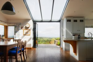 Barn conversion Kitchen with bifolding doors and large glazingk