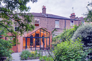 Timber clad extension glazed gable to Victorian terrace