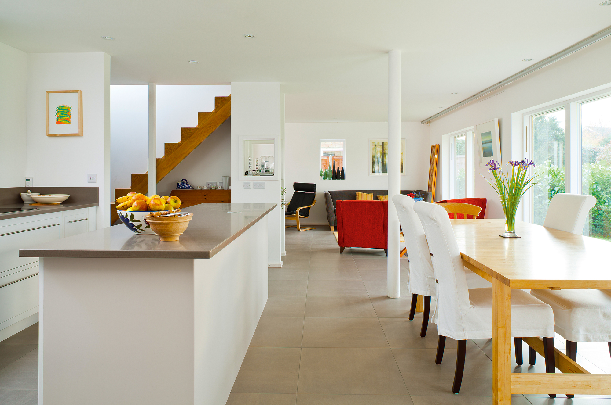 Open plan kitchen-dining-living space in Bungalow renovation by Mole Architects