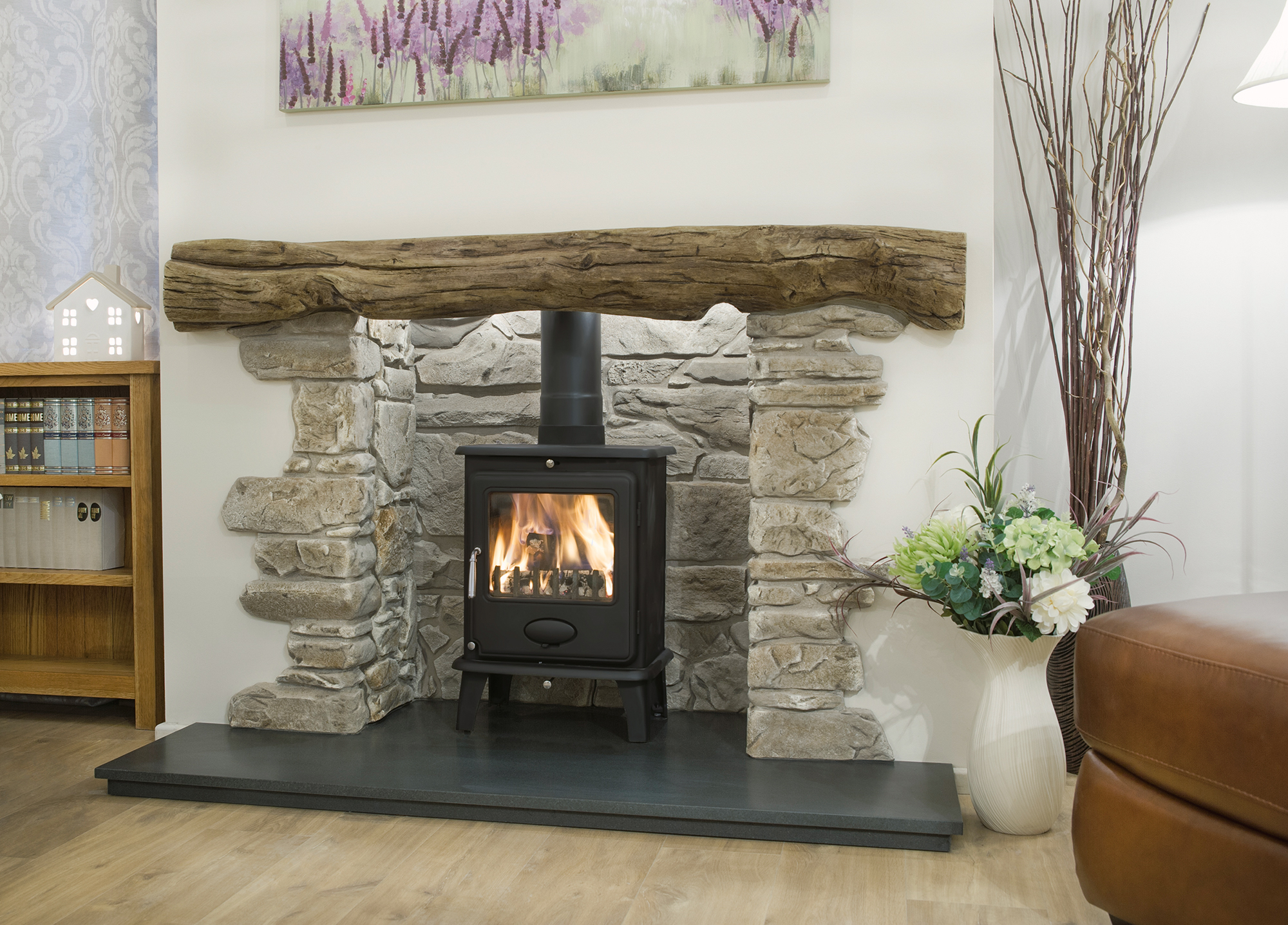 Traditional look stove installed in former fireplace space
