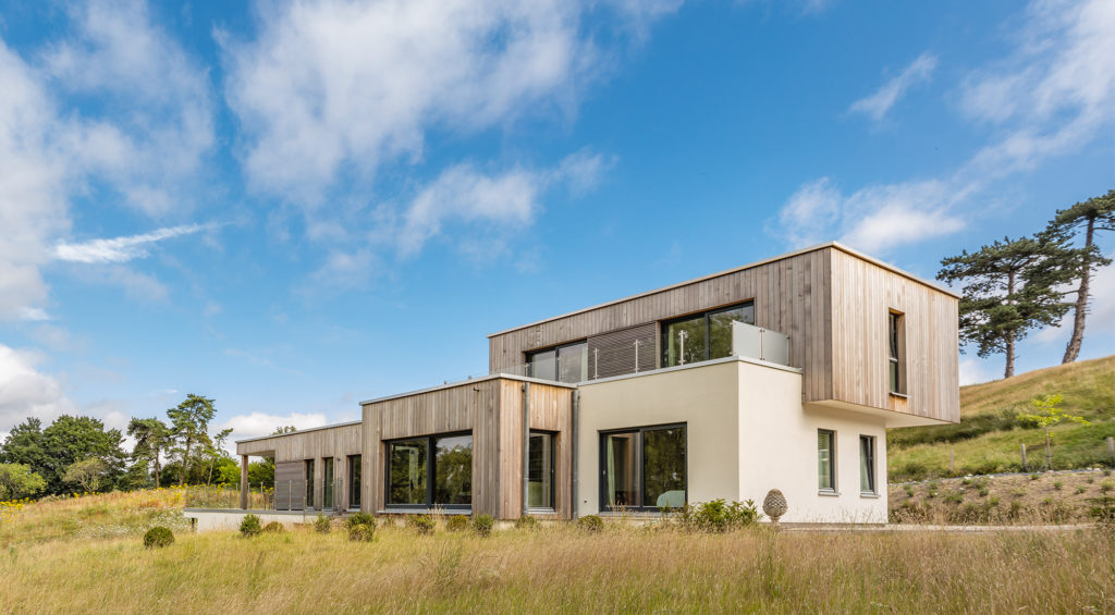 Contemporary home clad in timber and render