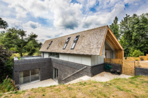 Contemporary timber frame home on sloping site by Frame Technologies