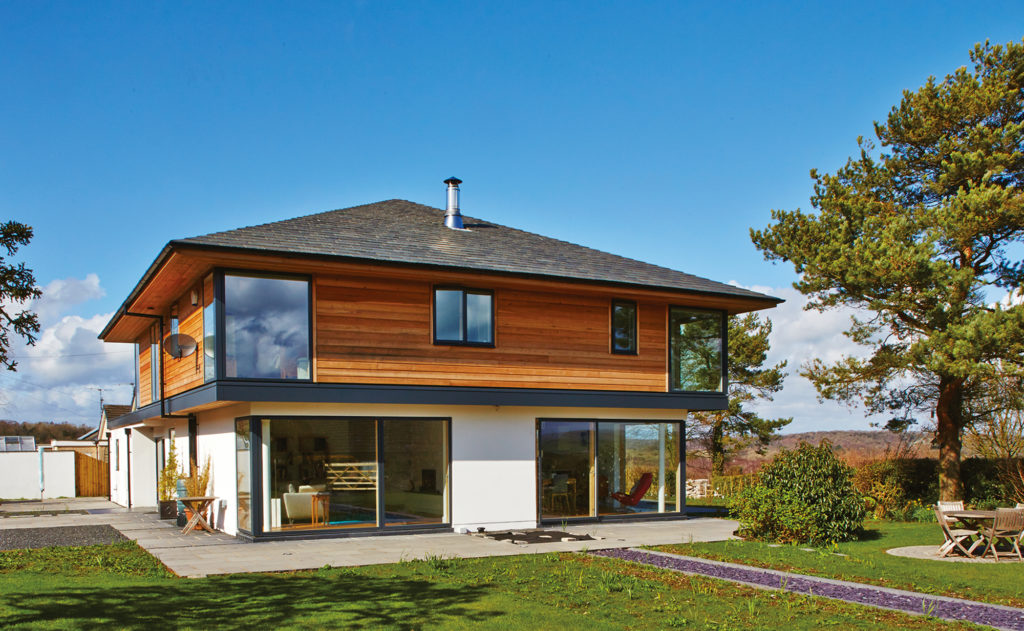 Timber frame home with cantilevered first floor