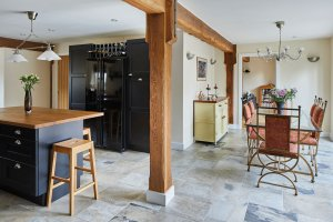 Open-plan kitchen-diner with exposed beams