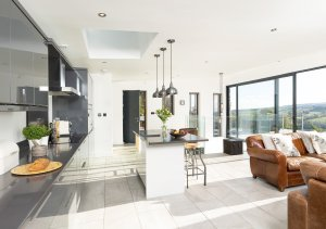 Open-plan kitchen with floor-to-ceiling glazing