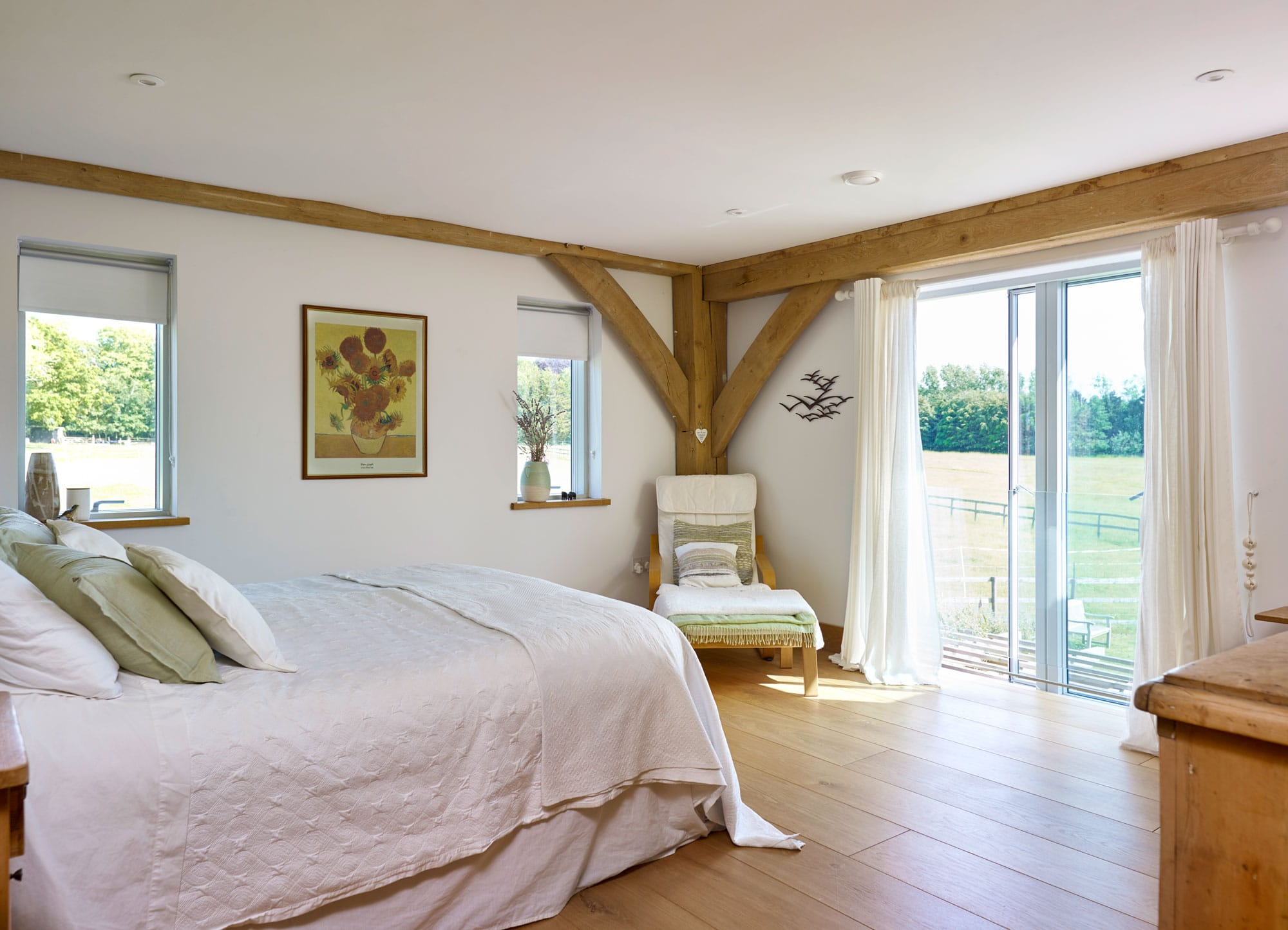 Bright bedroom with exposed floorboards