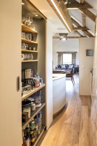 Open plan living space in cottage