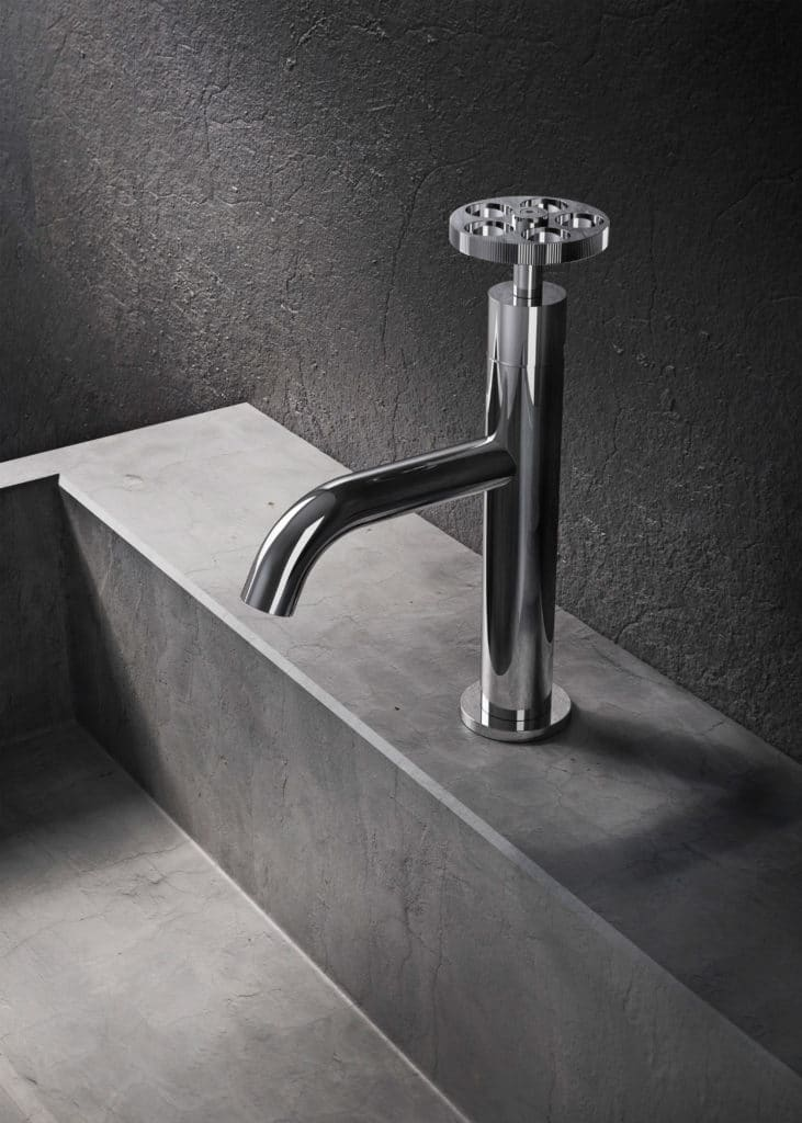 Silver tap in dark bathroom