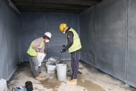Trades people building basement