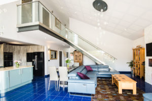 Living room with blue tiles and mezzanine