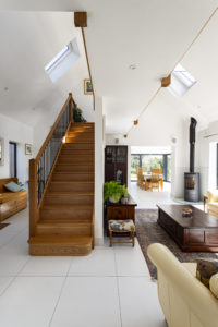 White hallway with stairs