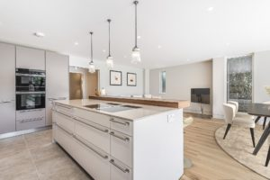 White open plan kitchen and dining area