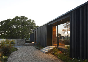 Black clad house with stairs